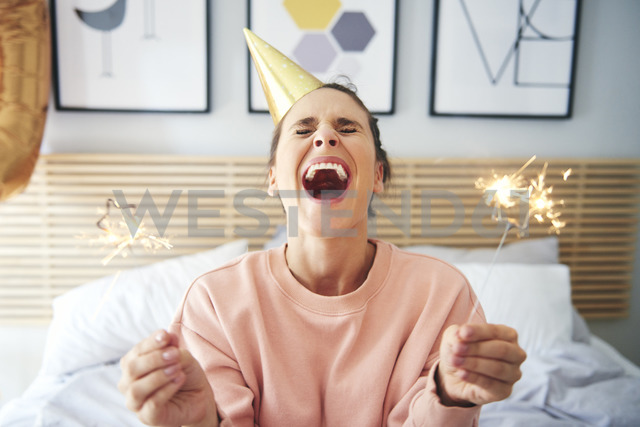 Cheerful woman during her birthday with sparklers - ABIF00978