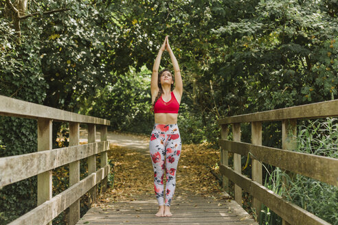 Young woman practicing Pilates in an urban park - NMSF00241