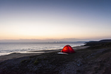 Red tent on a beach at night - UUF15164