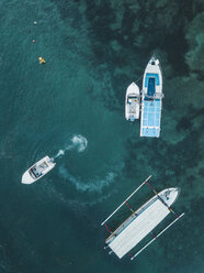 Indonesia, Bali, Aerial view of motorboats from above - KNTF01285