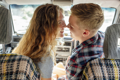 Romantic couple doing road trip, kissing in car - VPIF00599