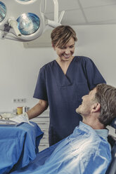 Dental surgeon talking to patient before treatment - MFF04568