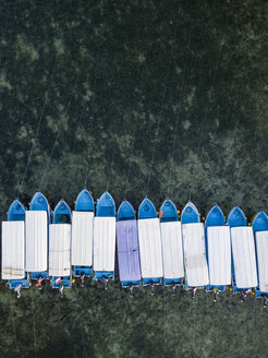 Indonesia, Bali, Benoa beach, Aerial view of moored boats in a row - KNTF01318