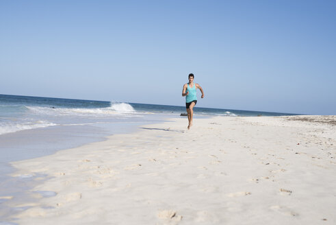 Spain, Canary Islands, Fuerteventura, young man running on the beach - PACF00135