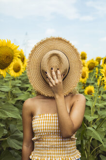 Unricognizable woman holding a straw hat in her face - ACPF00331