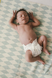 Newborn baby boy lying in diapers on a blanket - MFF04593