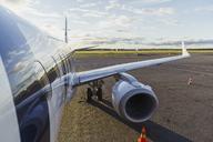 Wing of a plane standing in runway - KKAF01792
