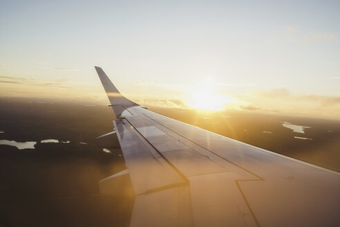 Wing of a plane at sunset - KKAF01798