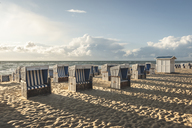 Germany, Schleswig-Holstein, Sylt, Westerland, hooded beach chairs on beach - KEBF00922