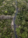 Indonesia, Bali, Aerial view of road and forest - KNTF01363