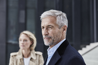 Portrait of mature businessman with grey hair and beard outdoors - RORF01517