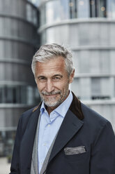 Germany, Duesseldorf, portrait of mature businessman with grey hair and beard outdoors - RORF01529