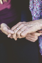 Cropped image of grandmother and granddaughter holding hands - MASF08932
