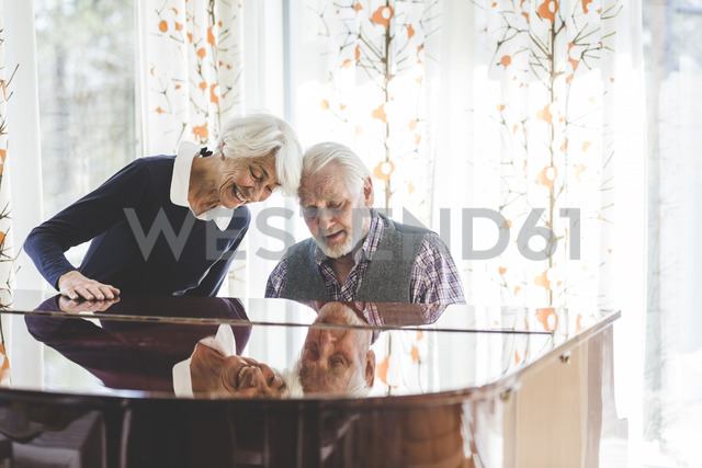 Senior couple playing piano together in nursing home - MASF08938