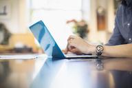 Man working at laptop - HOXF03870