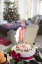 Decorated noel Christmas cake on sideboard in living room - HOXF03885