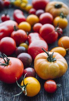 Different sorts of tomatos on woodden background - IPF00480