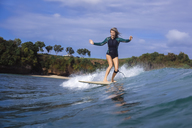 Indonesia, Bali, Balangan beach, surfer on a wave - KNTF01373