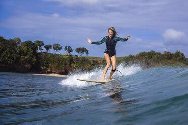 Indonesia, Bali, Balangan beach, surfer on a wave - KNTF01373