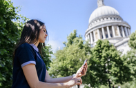 UK, London, young woman using her smartphone near St. Paul's Cathedral - MGOF03775