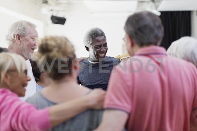 Active seniors forming circle huddle - CAIF21865