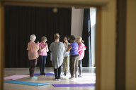 Serene active seniors practicing yoga in circle - CAIF21907