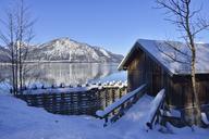 Germany, Bad Toelz-Wolfratshausen, boatshouse at Lake Walchen in winter - RUEF01921