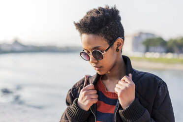 Portrait of young woman wearing sunglasses - GIOF04353