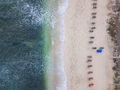 Indonesia, Bali, Aerial view of Balangan beach, empty sun loungers - KNTF01403