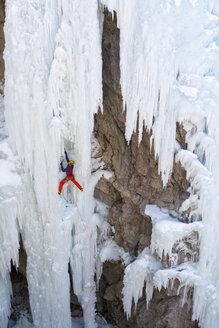 A man ice climbing near Ouray, Colorado. - AURF04042