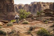 A man mountain biking in a dramatic desert environment. - AURF04078