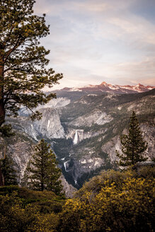 A view of mountains and waterfalls and trees at sunset. - AURF04138