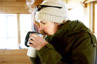 A women drinks a hot drink - AURF04156
