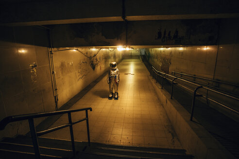 Spaceman in the city at night standing in underpass - VPIF00647