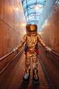 Spaceman in the city at night standing in narrow passageway - VPIF00653