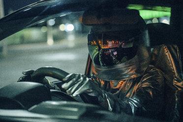 Spaceman driving car at night - VPIF00689