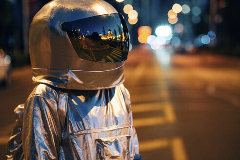 Spaceman on a street in the city at night - VPIF00713