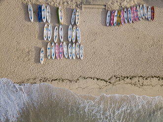 Indonesia, Bali, Aerial view of Pandawa beach, empty canoes - KNTF01432