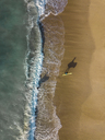 Indonesia, Bali, Aerial view of Pandawa beach, two surfers - KNTF01444