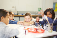Curious kids conducting science experiment - CAIF22096