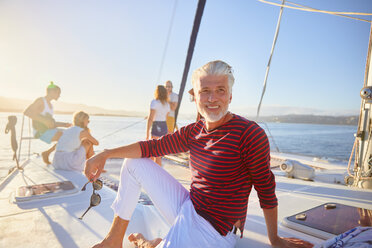 Portrait smiling man relaxing on sunny boat - CAIF22132