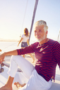 Portrait confident man relaxing on sunny boat - CAIF22150