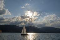 Germany, Bavaria, Upper Bavaria, Tegernsee valley, lake Tegernsee, Bad Wiessee, Sailing boat at sunset, seen from peninsula Point - LBF02037