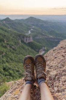 Spain, Barcelona, Montserrat, feet of resting man - AFVF01555