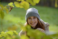 Portrait of smiling teenage girl in autumnal forest - LBF02054