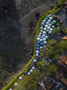 Indonesia, Bali, Aerial view of sunshades at Tanah Lot-temple - KNTF01508