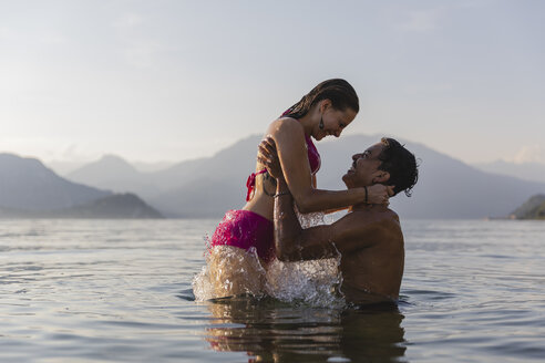 Happy affectionate young couple in a lake - MRAF00284