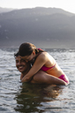 Happy playful young couple in a lake - MRAF00290