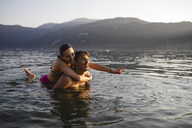 Happy carefree young couple in a lake - MRAF00299