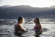 Young couple having fun in a lake - MRAF00305